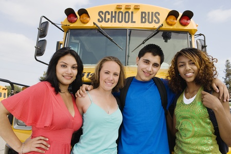 Teenagers by School Bus Stock Photo - 12736444