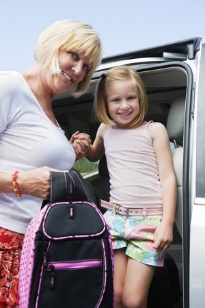 45 to 50 year olds: Mother Driving Daughter to School