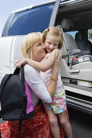 schoolchildren: Mother Driving Daughter to School