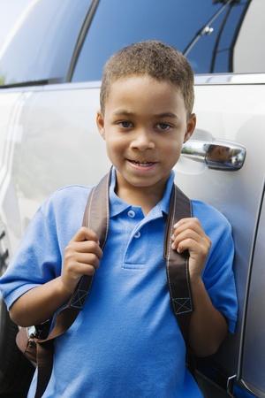 ethnic mixes: Boy Standing by Minivan