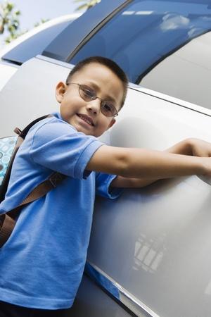half length posed: Boy Standing by Minivan