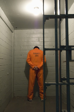Prisoner standing against the wall Stock Photo - 12736462