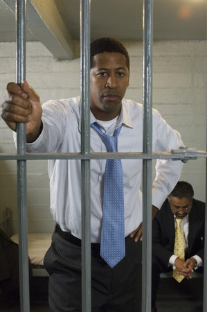 Man in prison cell Stock Photo - 12736475