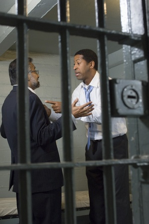 Two men arguing in prison cell Stock Photo - 12736476