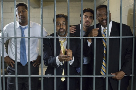 Four people in prison cell Stock Photo - 12736483