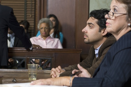 witness: Defense lawyer with client in court