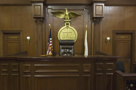 Legal scales behind judges chair in court Stock Photo - 12736505
