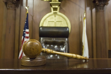 Hammer and gavel near judges chair in court Stock Photo - 12736512