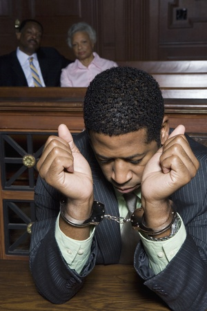 Criminal sitting in court Stock Photo - 12736538