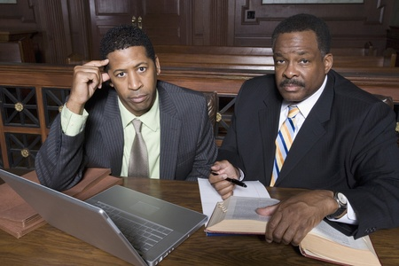 Two men sitting in court portrait Stock Photo - 12736542