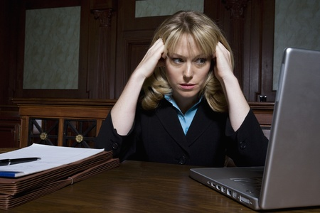 Woman using laptop in court Stock Photo - 12736554