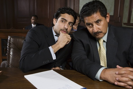 conferring: Two men sitting in court LANG_EVOIMAGES