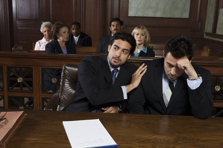 court room: Two men sitting in court LANG_EVOIMAGES