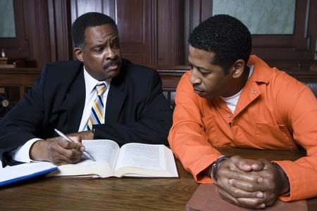 Criminal with lawyer in court Stock Photo - 12736576
