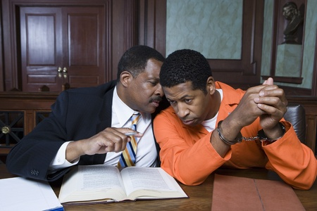 criminal activity: Criminal with lawyer in court