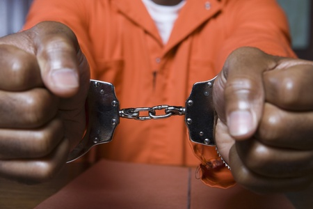 Handcuffed criminal close-up Stock Photo - 12736578