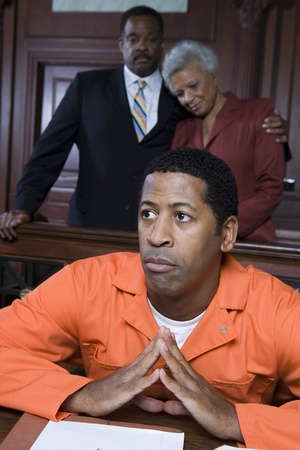 Criminal sitting in court Stock Photo - 12736585