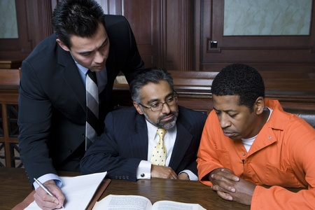 court room: Criminal with two lawyers in court