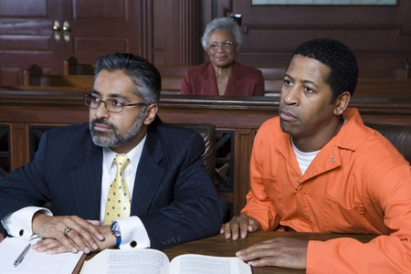 Lawyer and criminal sitting in court Stock Photo - 12736588