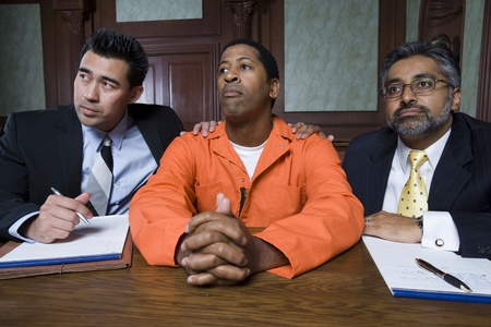 middle easterners: Lawyers with criminal in court