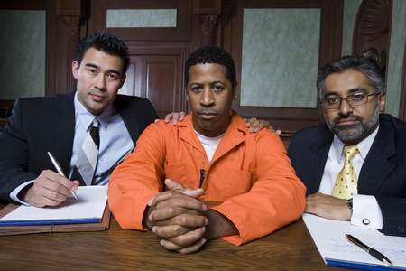 Lawyers with criminal in court Stock Photo - 12736596