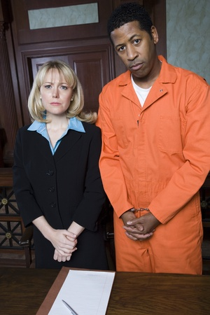 Lawyer with criminal in court portrait Stock Photo - 12736600