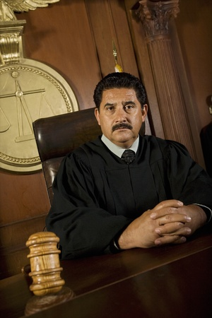 middle easterners: Judge sitting in court portrait