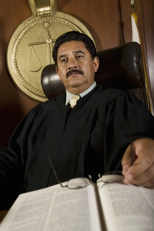 Pensive judge in court Stock Photo - 12736615