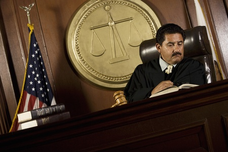 court room: Judge reading in court