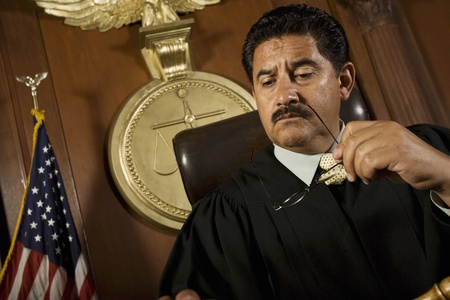 middle easterners: Pensive judge sitting in court LANG_EVOIMAGES
