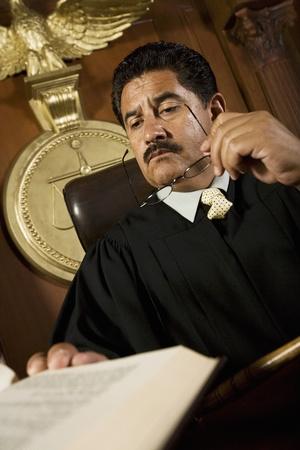 court judge: Judge reading in court