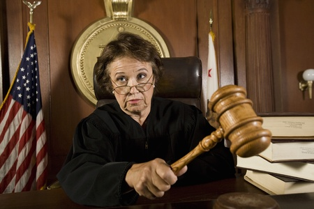 Judge using gavel in court Stock Photo - 12736634