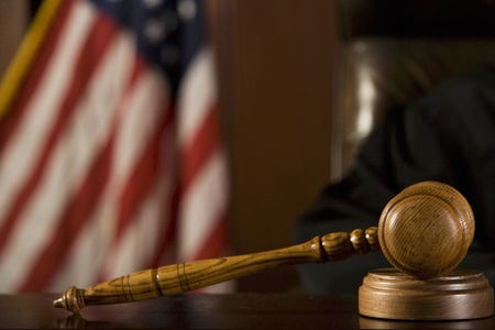 courtroom: Gavel lying in front of a judge LANG_EVOIMAGES