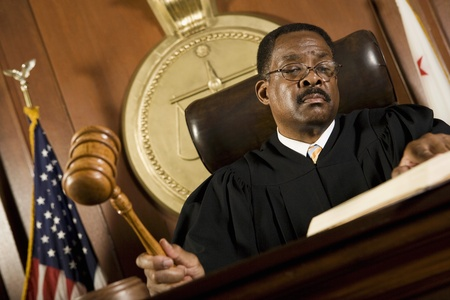 court judge: Middle-aged judge forming sentence