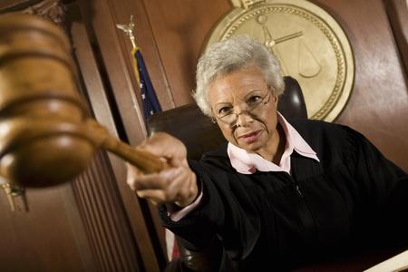 female judge: Female judge holding hammer in court LANG_EVOIMAGES