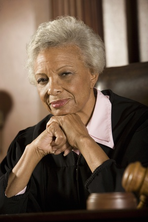 Female judge sitting in court portrait Stock Photo - 12736680