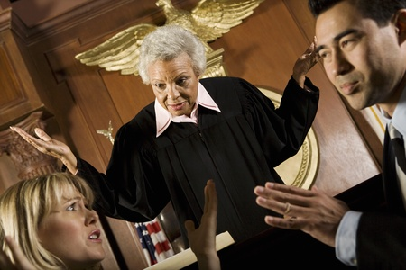 Couple arguing in front of judge in court Stock Photo - 12736686