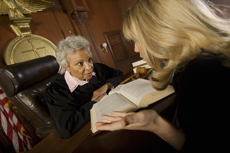 Woman pleading with judge in court room Stock Photo - 12736692
