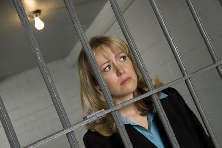 woman prison: Female criminal behind bars in jail