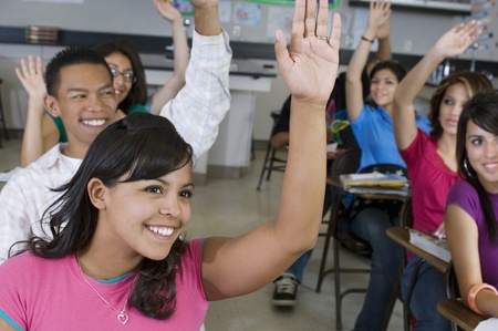 16 to 17 year olds: High School Students Raising Their Hands in Class