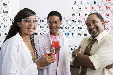 45 to 50 year olds: Science Students with Beakers