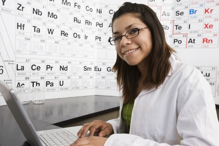 Student in Science Class with Laptop Stock Photo - 12736744
