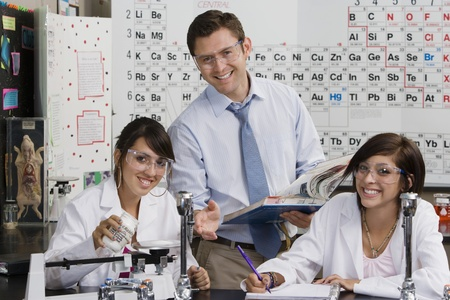 40 to 45 year olds: Science Teacher Helping Student LANG_EVOIMAGES