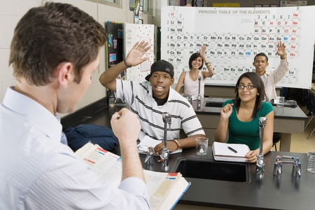 16 to 17 year olds: Teacher Calling on Student in Science Class LANG_EVOIMAGES