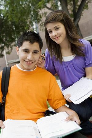 teenaged boys: High School Couple Studying