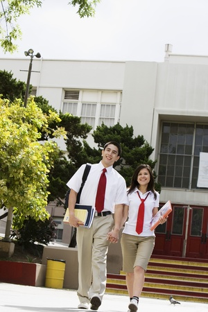 secondary education: High School Couple Walking in Front of School