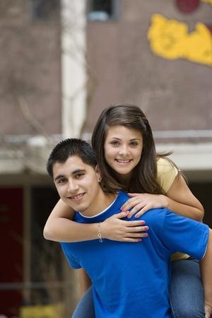 teenaged boys: Teenage Boy Giving Girlfriend Piggy Back Ride