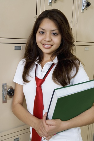 High School Girl Holding Textbook by School Lockers Stock Photo - 12736793