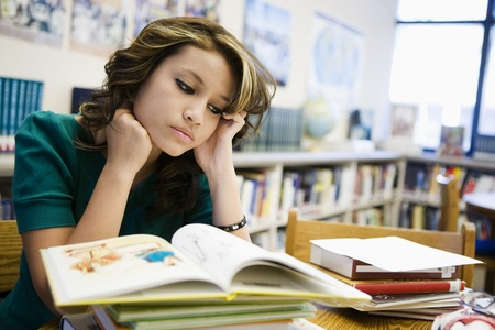 High School Student Studying in Library Stock Photo - 12736821