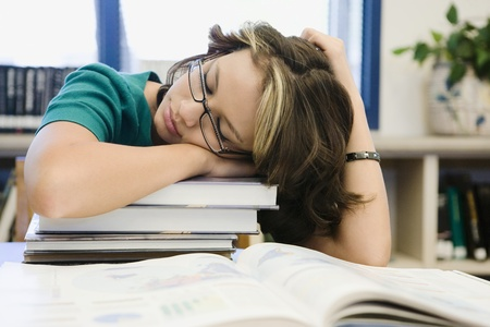 weary: High School Student Sleeping in Library